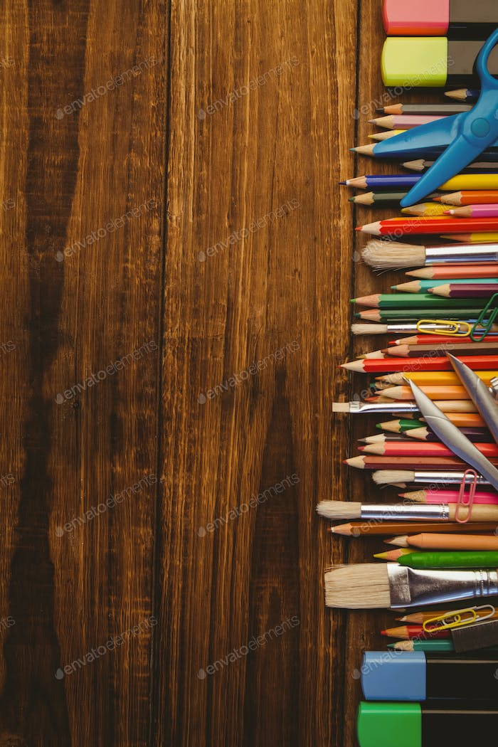 Art supplies on desk with copy space shot in studio