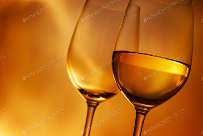 Two wineglasses, one with white wine