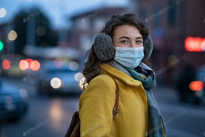 Woman wearing face mask on city street