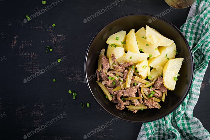 Stew beef, pieces of beef stewed with pickled cucumber in russian style