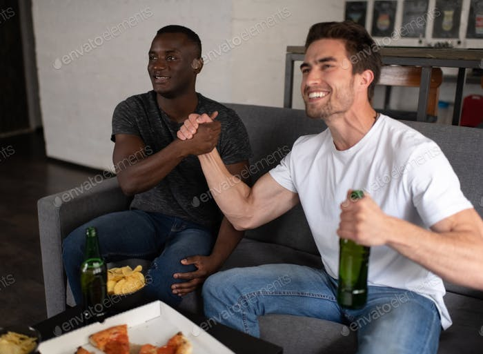 Football fans celebrating victory of favorite team