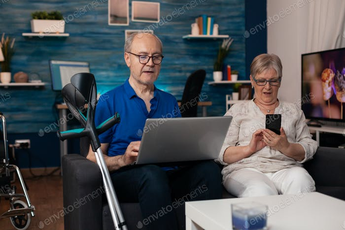 Senior family using modern technology devices