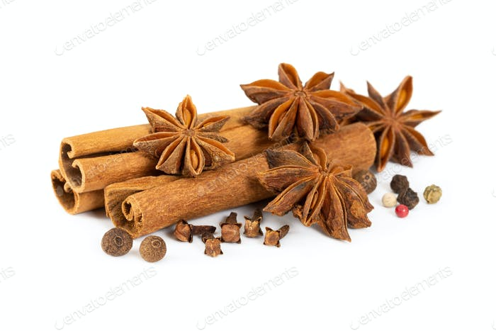 Cinnamon, star anise, cloves and mixture of peppers isolated on white