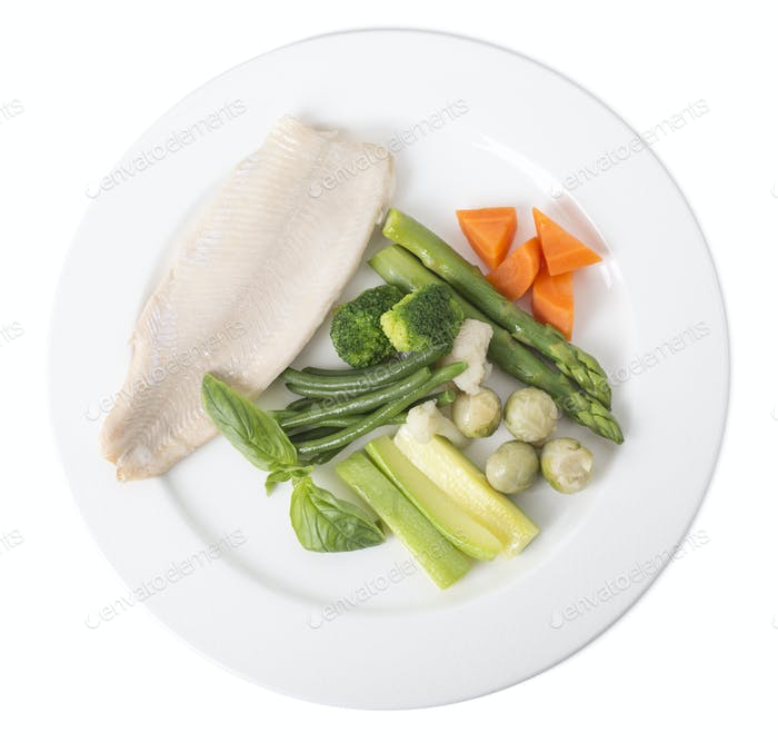 Steamed trout fillet with vegetables.