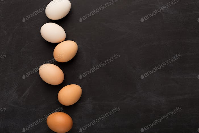 Minimalistic background with gradientof natural colored eggs