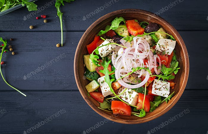 Greek salad with fresh tomato, cucumber, red onion, basil, feta cheese, black olives