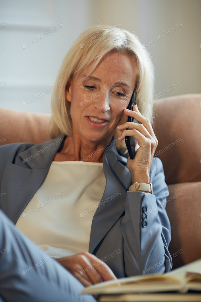 Elegant Mature Businesswoman Speaking by Phone