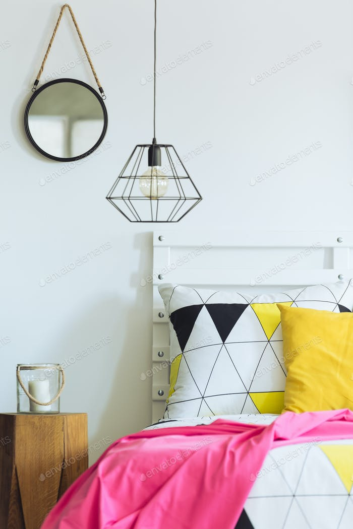 Geometric bedroom with round mirror