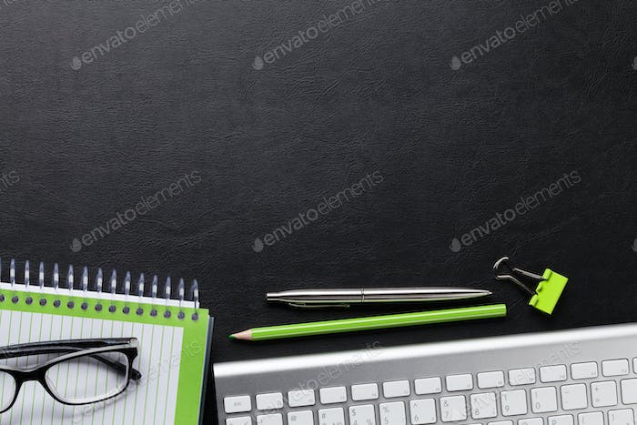 Office desk with computer and supplies