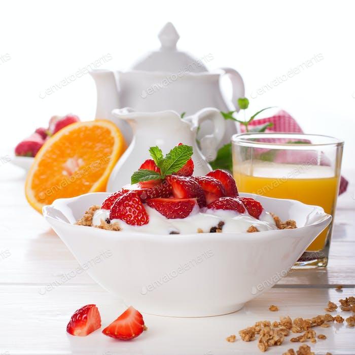 Yogurt with granola and fresh strawberries