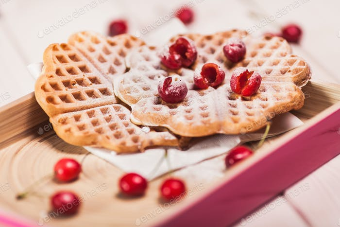 Close up of sweet waffles with cherry