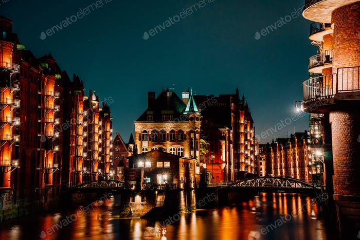 Hamburg, Germany. View of Wandrahmsfleet at dusk in light illumination. Located in Warehouse
