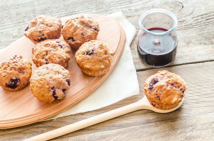 Cherry muffins on the wooden board