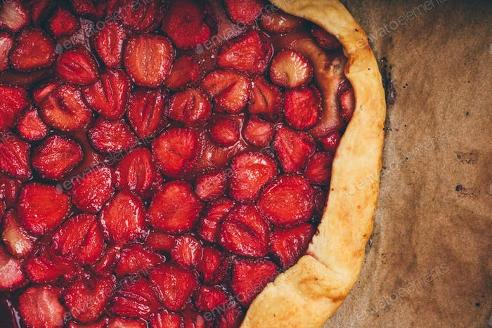 Part Of Baked Strawberry Galette On Baking Paper