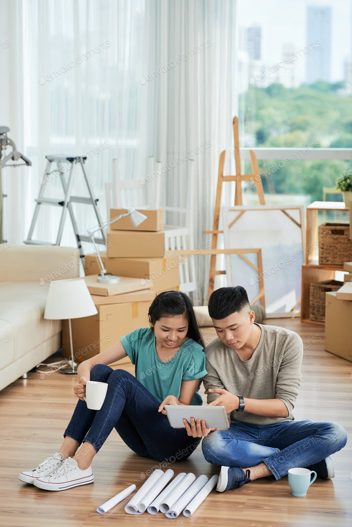 Couple with tablet pc in the apartment