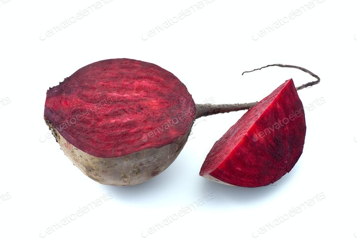 Half and slice of red beet