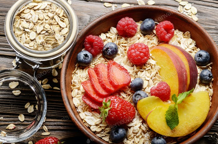 Flat lay of fruit healthy muesli with peaches strawberry almonds