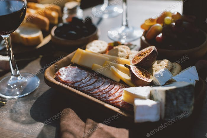 close-up shot of tray with various snacks for red wine