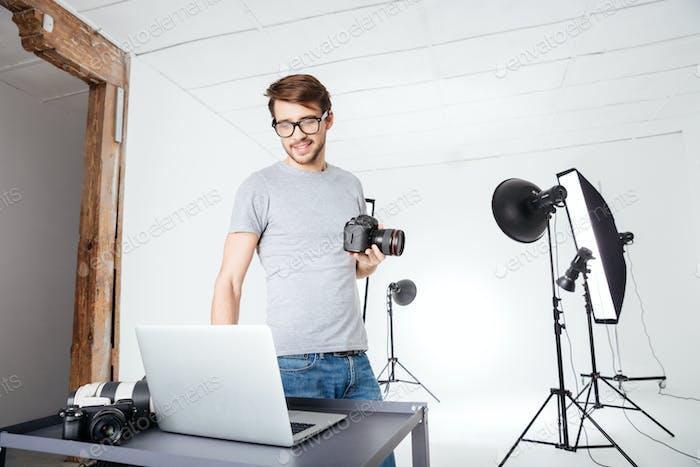 Photographer using laptop computer