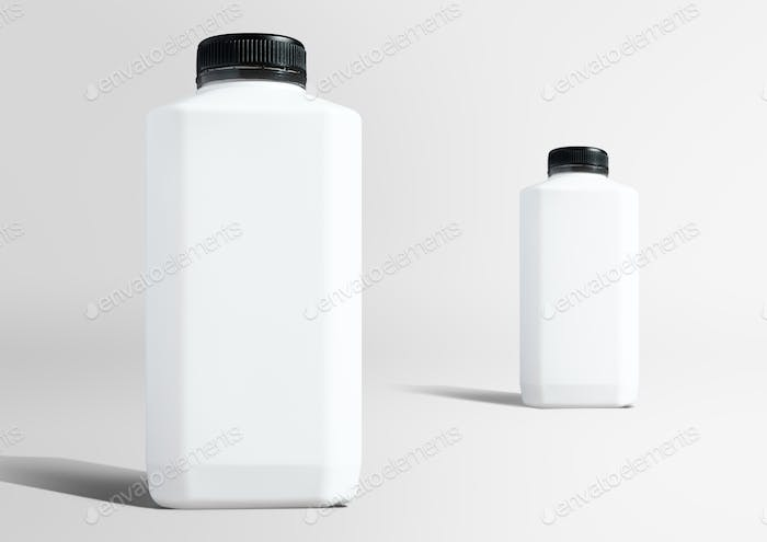 Blank white plastic bottles setting up in studio ready to use as