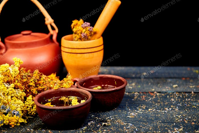 Healing herbs on wooden black table, herbal medicine
