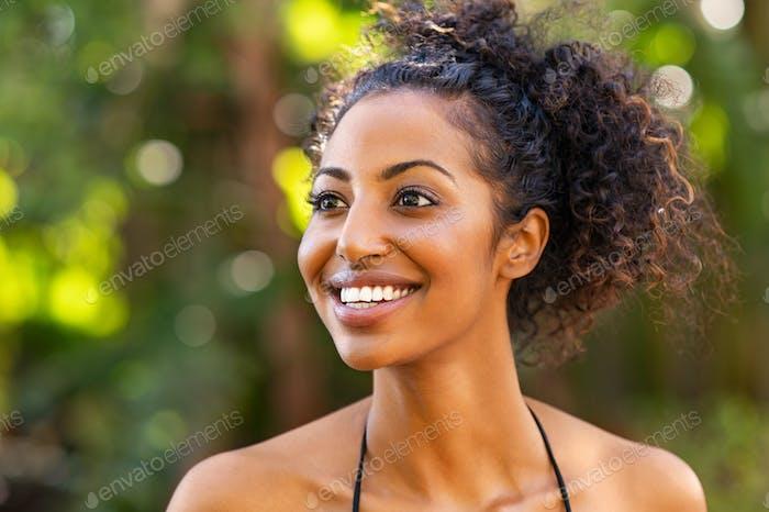 Joyful woman in bikini laughing