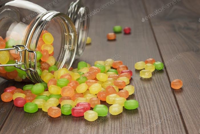 Toppled Over Glass Jar Full Of Colorful Sweets