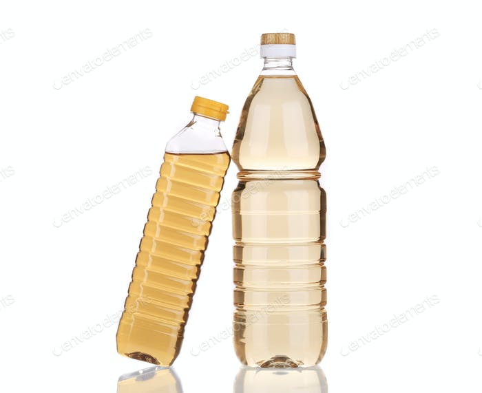 Two bottles of vinegar.