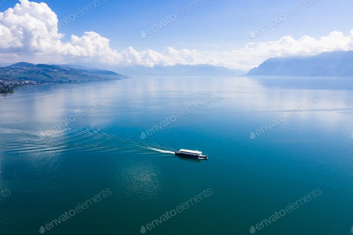 Aerial view of boat leaving Ouchy waterfront in  Lausanne, Switz