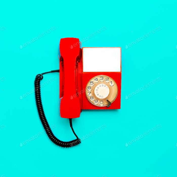 Vintage red telephone. Minimal design