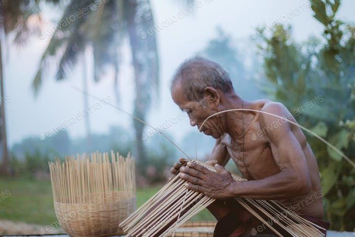 Old man are weaving on field