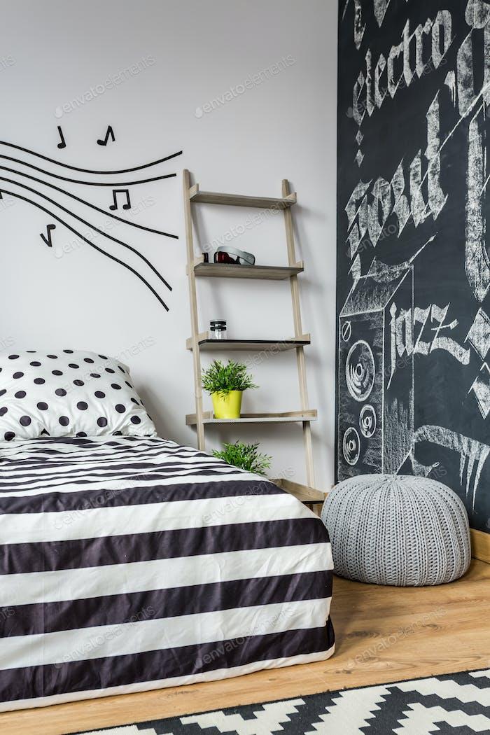 Bedroom with a blackboard wall