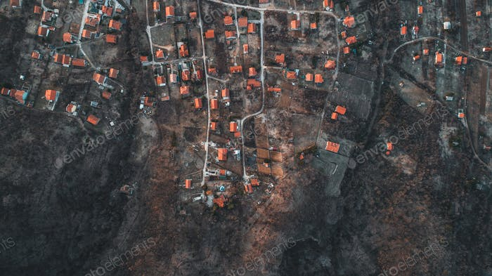 Overhead Aerial Shot of settlement in rural area .Shot From air.