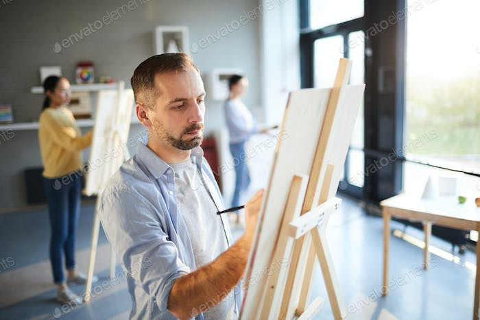 Man painting in studio