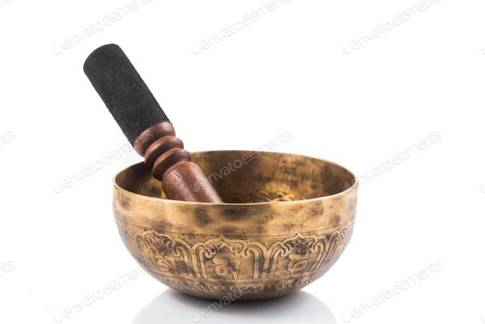 Nepali singing bowl isolated in white