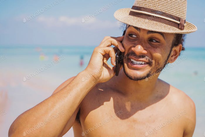 Cheerful man standing with smartphone