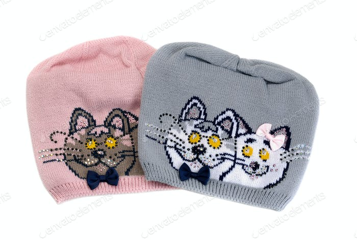 Two color knit cap with a pattern of a cat.