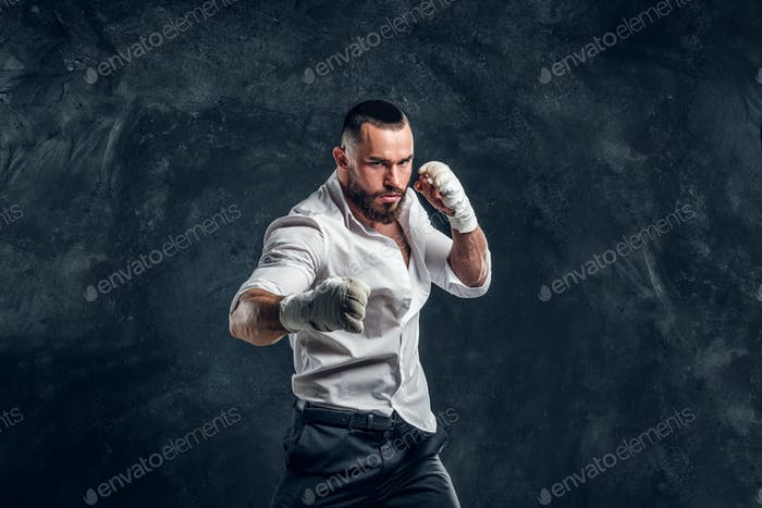 Portrait of handsome bearded man in boxing gloves