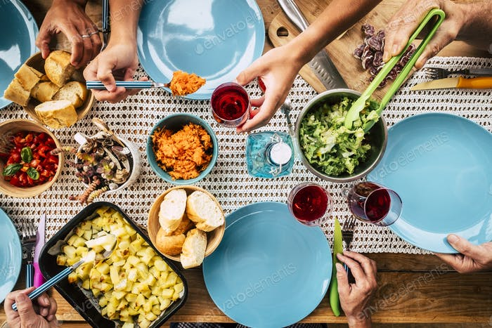 Top vertical coloured view of table full of food and colors