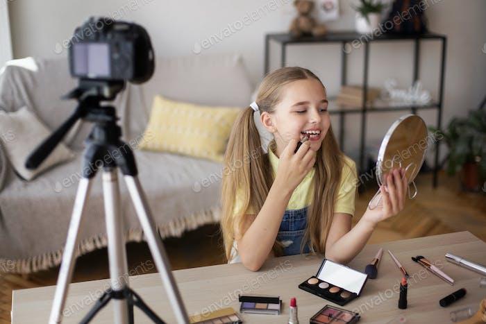 Smiling Girl Applying Makeup, Recording Her Beauty Blog