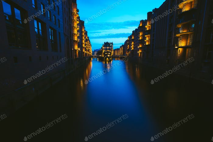 Wide perspective of Warehouse District - Speicherstadt in twilight. Blue hour. Tourism landmark of