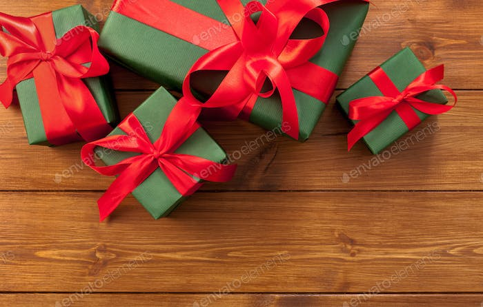 Presents in gift boxes on wood background