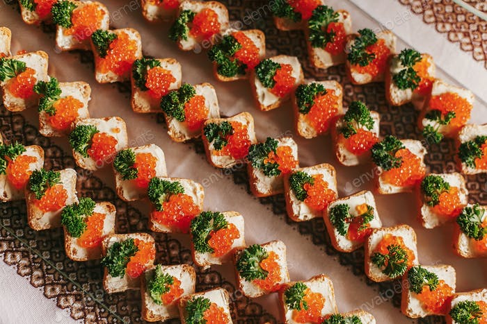 Delicious finger appetizers table at wedding reception