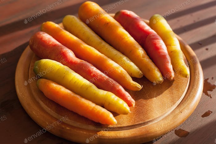 raw colorful carrot vegetable on wooden background