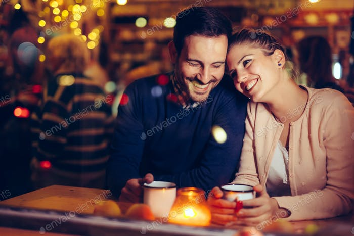 Romantic couple dating in pub at night