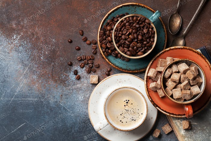 Coffee cup, beans and sugar