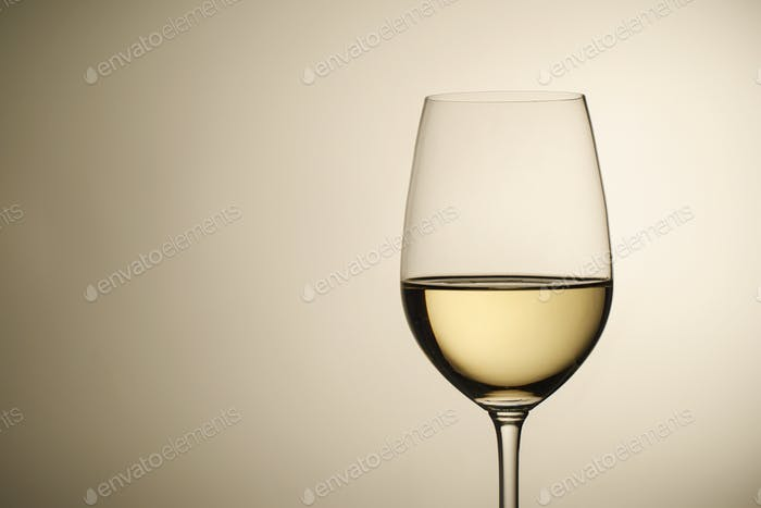 Wineglass with white wine and copy space