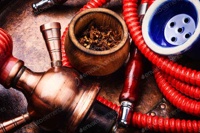 Smoking shisha with tobacco