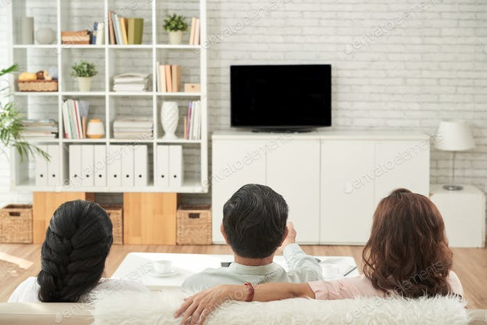 Old friends watching tv