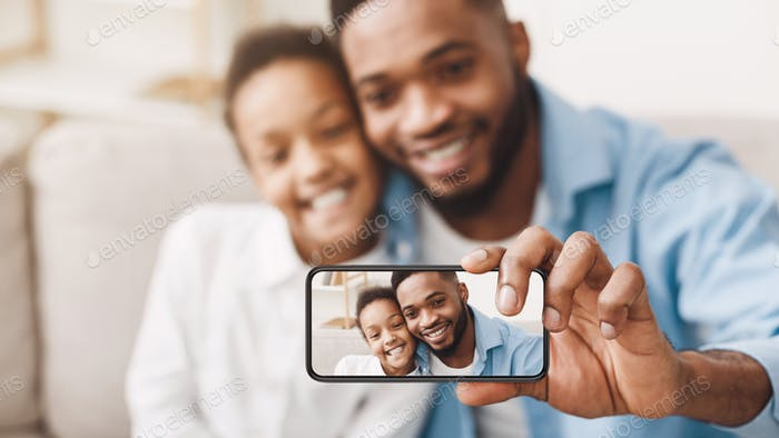 Selfie With Dad. Father And Daughter Taking Photo On Phone